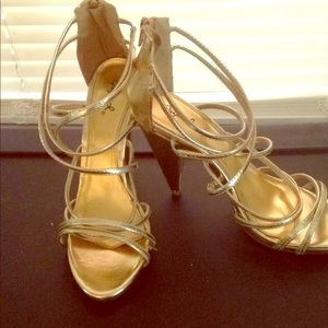 Gold strappy high heels